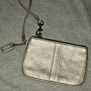 Coach metallic silver leather wristlet